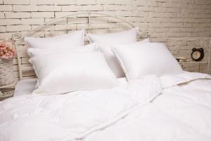 Как правильно ухаживать за одеялом с наполнителем из пуха-пера?